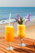 pineapple, mango and passion fruit juice - stock photo