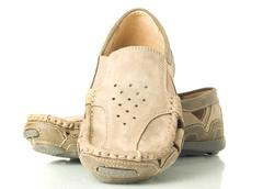 pair of modern beige moccasins - stock photo