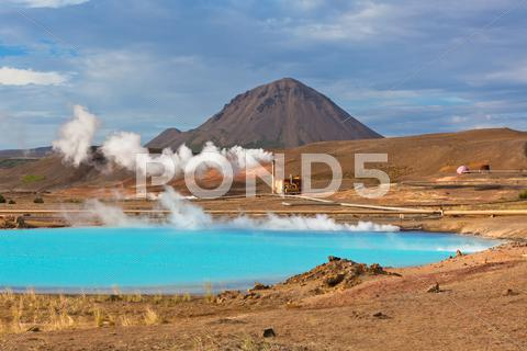 Stock photo of geothermal power station and bright turquoise lake in iceland