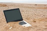 Laptop personal computer on the beach Stock Photos