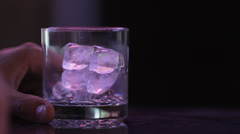 Pouring Booze on Ice CU Stock Footage