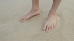 Man's Feet in sand slow CU Stock Footage