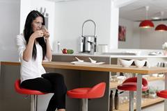 woman taking a coffee break - stock photo