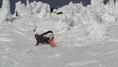 Stock Video Footage of Falling while Snowboarding on a Ski Resort at Canadian Mountains