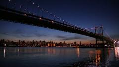 City across the river and bridge in the evening 25p Stock Footage