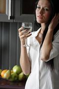 Woman in her stylish kitchen Stock Photos