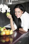 woman eating an apple - stock photo