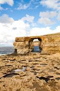 natural rock arch azure window, gozo - stock photo