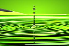 Water droplet and waves over green Stock Photos