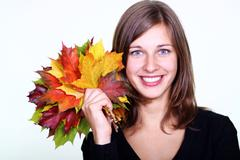 beautiful young woman and maple leaves ... - stock photo