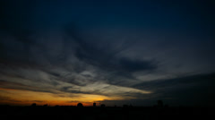 Sunset over the city, transition from day to night (time lapse / timelapse) - stock footage