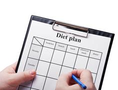 Draw up a diet plan isolated Stock Photos