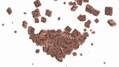 Falling brownies shaping a heart Stock Footage