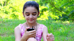 Girl listening to music on a smartphone - stock footage