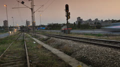 Railway / train station near the city center during evening Stock Footage