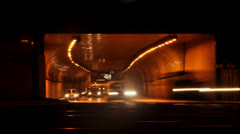 Night in the city, cars, public transportation on the tunnel entrance Stock Footage