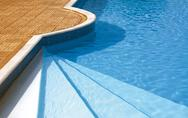 Steps to the swimming pool. rippled water under sunlight Stock Photos