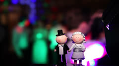 Wedding couple figures on cake during party Stock Footage