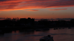 River boat crosses Thames under red sky - stock footage