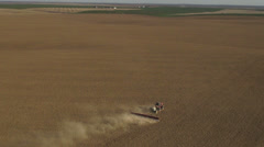 Aerial - Tractor seeding spring wheat Stock Footage
