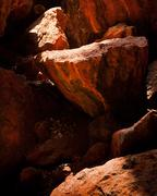 Colorful texture of rocks inside mountain cave darkness Stock Photos