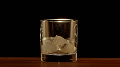Whiskey poured into glass in slow motion Stock Footage