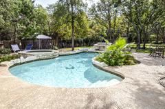 Upscale Backyard Kidney Shaped Swimming Pool Stock Photos