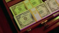Briefcase breifcase full of money cash bribe bribery Stock Footage