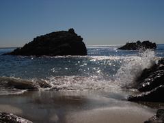 Wave Splashes Rocks Stock Photos