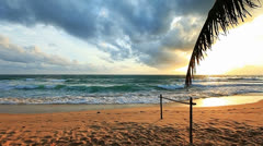 Tropical beach at sunset - stock footage