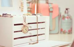 jewelry with vintage clock and female complements in soft pastel colors - stock photo