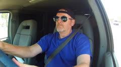 Older Man Driving Van On Los Angeles Street - stock footage