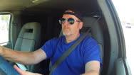 Older Man Driving Van On Los Angeles Street Stock Footage