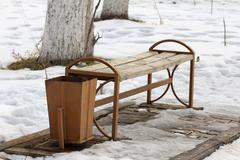 bench in the park in winter - stock photo