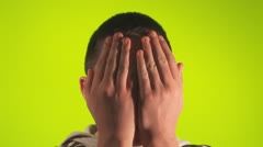 Preteen scared covers face Stock Footage