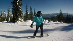 A woman enjoying her day of Snowboarding on a Ski Resort at Canadian Mountains Stock Footage