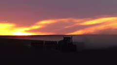 Tractor seeding spring wheat - stock footage