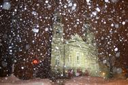 Church at night with falling snow Stock Photos