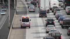 Ambulance in freeway traffic Stock Footage