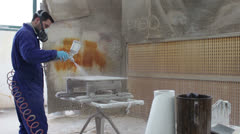 Worker painting in a factory - industrial painting with spray gun - dolly Stock Footage