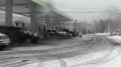 Snowstorm-Cars Last Minute Gas.mp4 Stock Footage