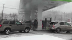 Snowstorm-Cars Last Minute Gas 2.mp4 Stock Footage