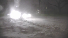 Snowstorm-Night Cars Travel Unplowed Street 2.mp4 Stock Footage