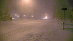 Snowstorm-Night-Pickup with plow flashing light drives by.mp4 Stock Footage
