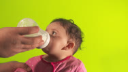 Stock Video Footage of Parent feeding baby milk