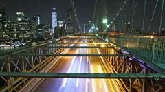 Time lapse of city traffic on Brooklyn bridge at night - stock footage