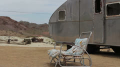 Abandoned Camper in Desert with Rocking Chair Stock Footage