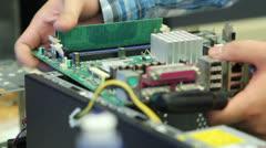 IT Technician Repairs Computer RAM Memory - stock footage
