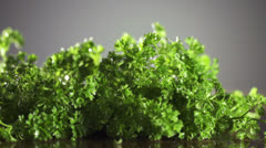 Parsley with knife on wooden cutting board. Macro with shallow dof. - stock footage