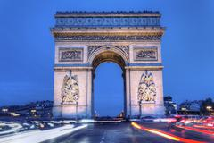 The arc de triomphe by night Stock Photos